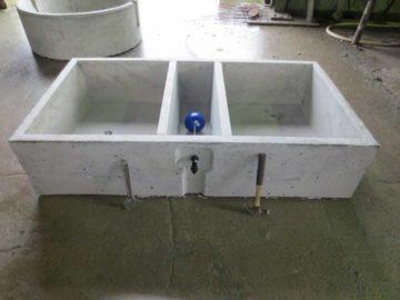Double chamber ballcock protector trough